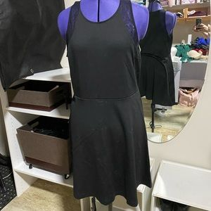 Black fit and flare dress with see through accent